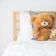 Cute teddy bears in kids white room.